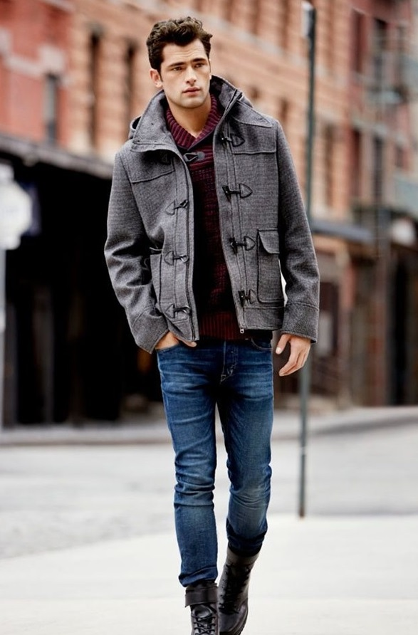 blue jeans, a red sweater and a grey duffle coat