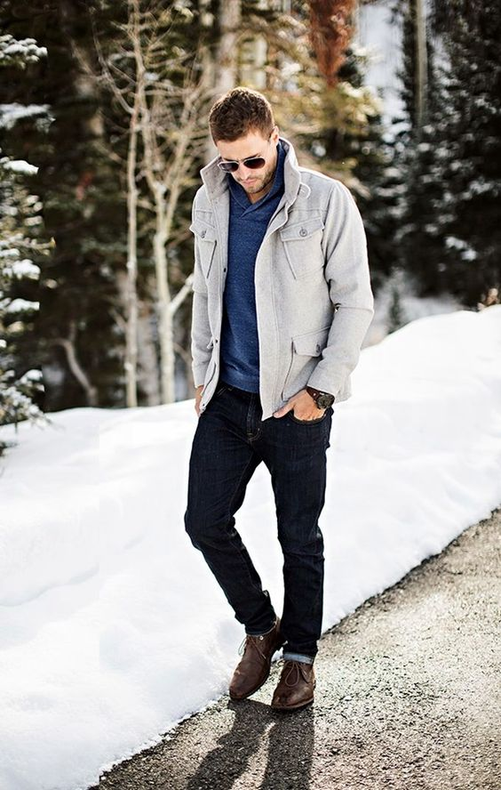 dark denim, a blue sweater, a dove grey coat and brown boots