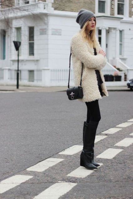 With black mini dress, tights, high boots and gray beanie
