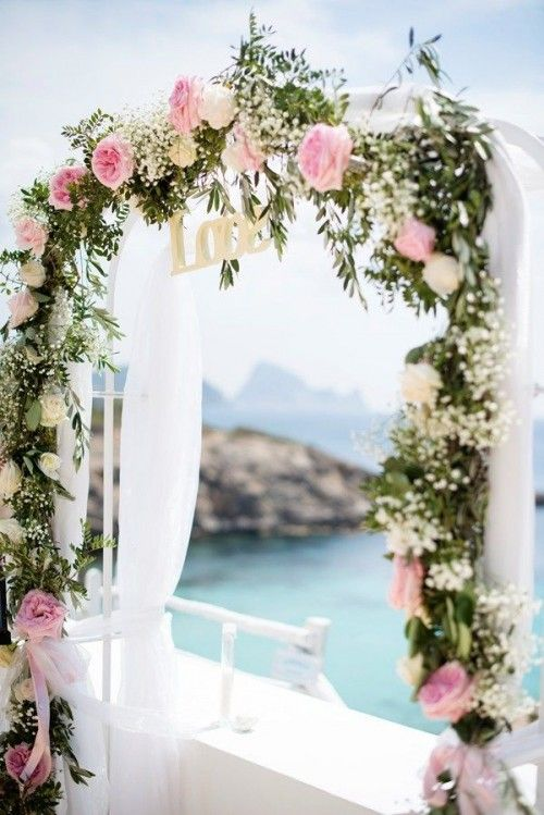 romantic arch topped with baby