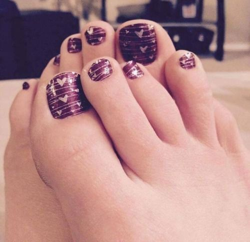 dark purple pedicture and pink hearts on it