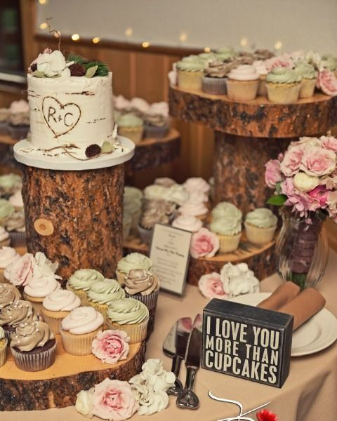 wood slice dessert bar with caupcakes and cakes