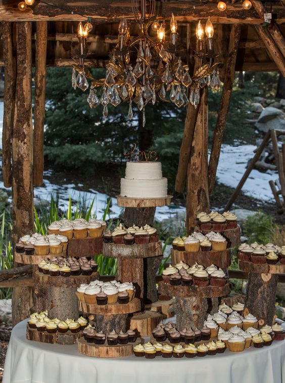 dessert table with wood slices as stands