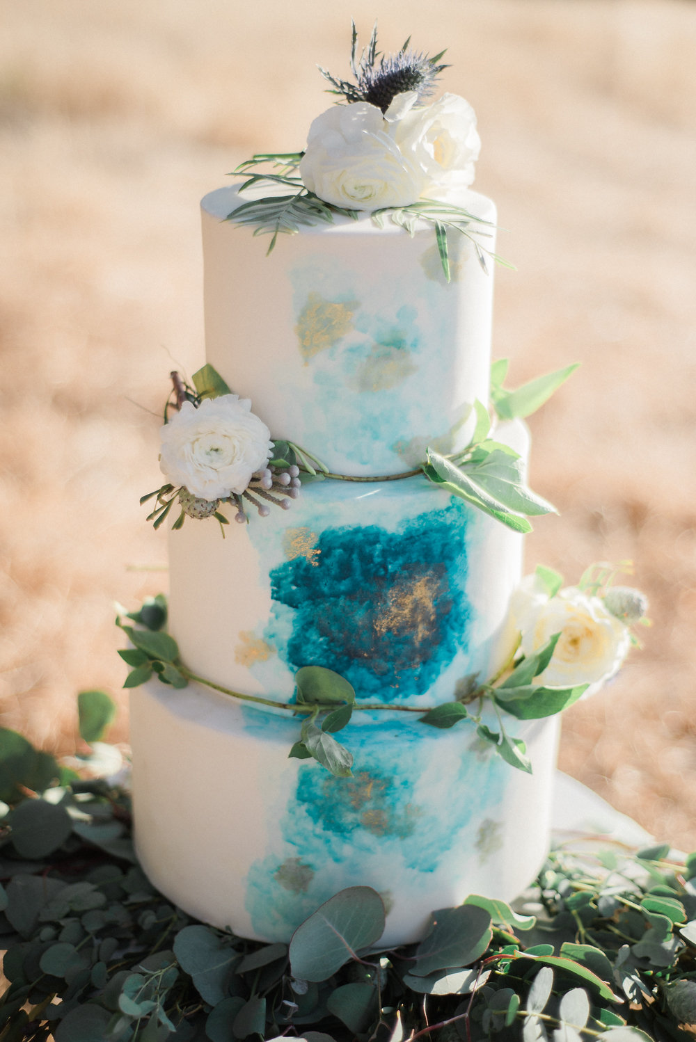 blue painted wedding cake - photo by Anya Kernes Photography http://ruffledblog.com/organic-wedding-inspiration-with-shades-of-blue