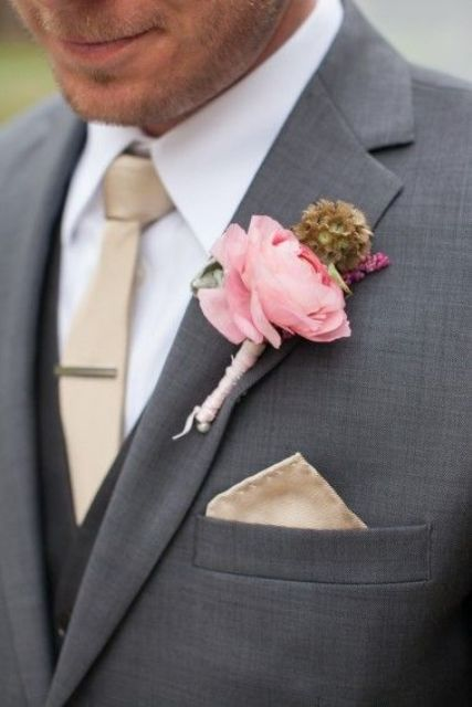 dark grey suit,a beige tie and a pink boutonniere