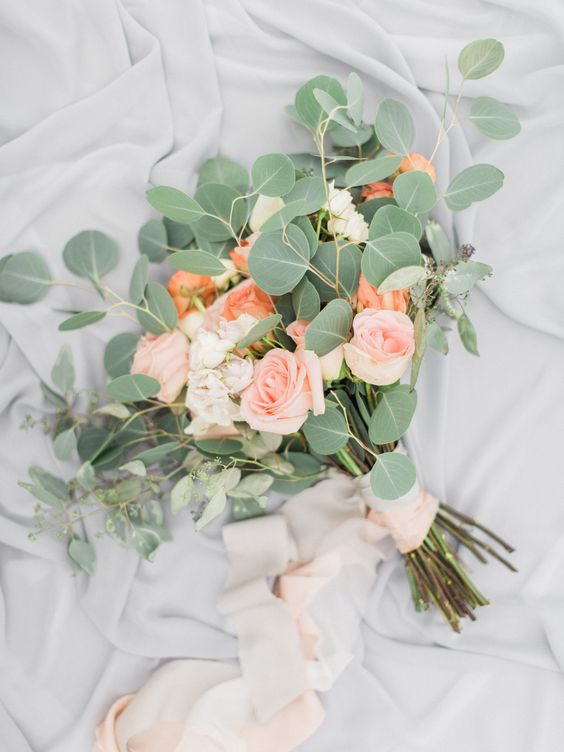 eucalyptus and peach-colored roses wedding bouquet