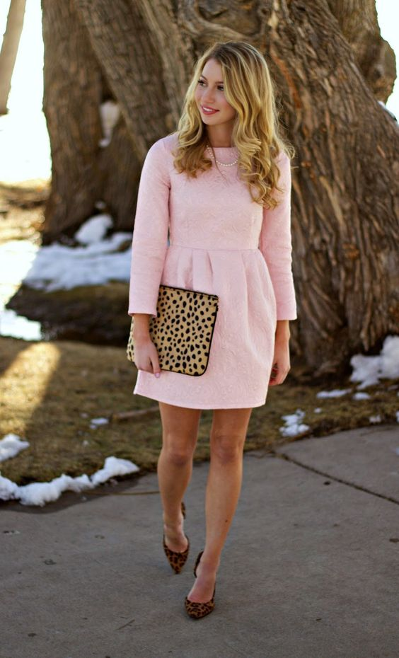 a blush mini dress with leopard heels and a clutch