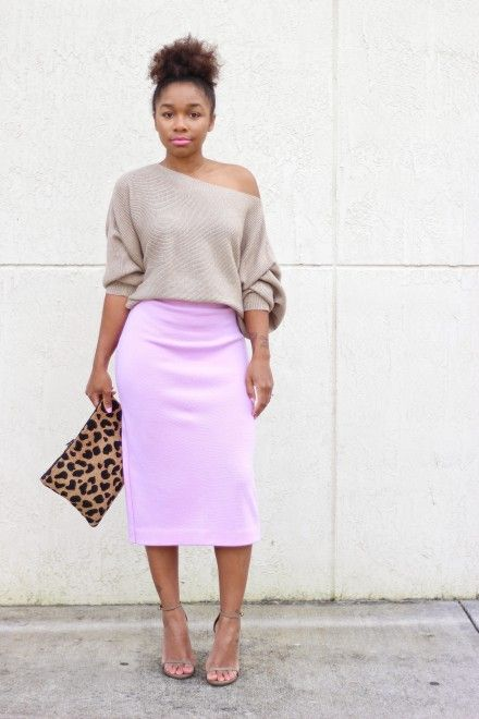 neon pink midi skirt and a neutral one-shoulder sweater