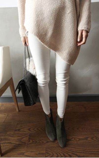 white jeans, a blush oversized sweater and dark grey ankle boots