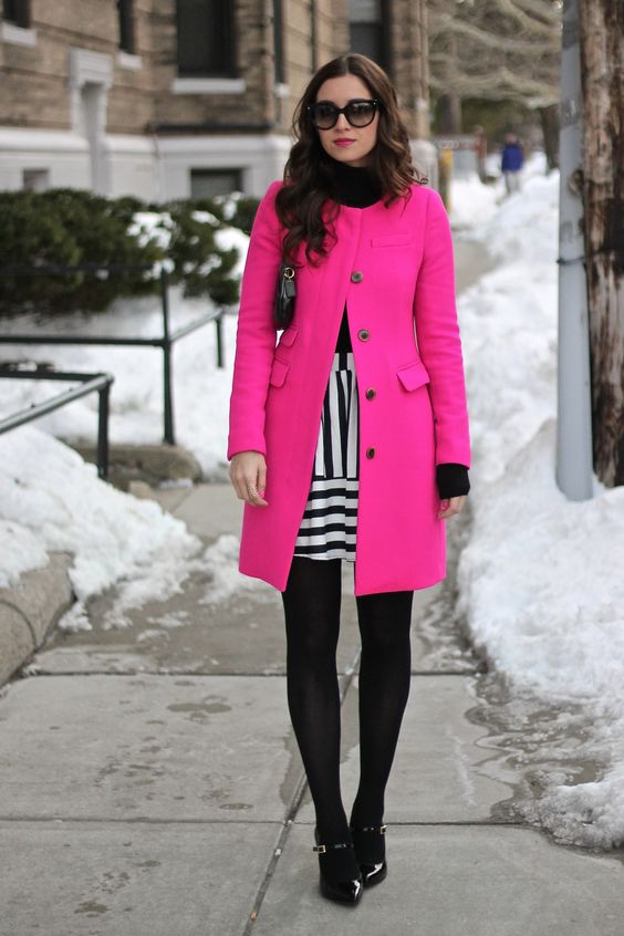 hot pink coat and black and white stripes are super stylish
