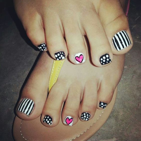 whimsy graphic nail art with stripes, polka dots and hearts