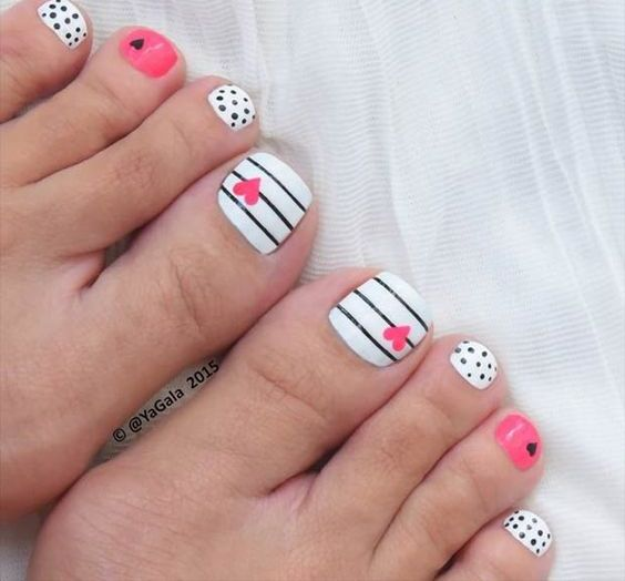 black, white and pink toe nails with polka dots, stripes and hearts