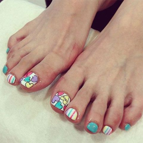 colorful toe nails with stripes and hearts