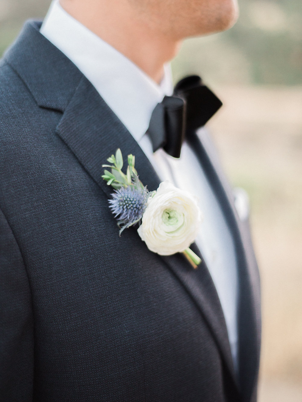 ranunculus boutonnieres - photo by Anya Kernes Photography http://ruffledblog.com/organic-wedding-inspiration-with-shades-of-blue