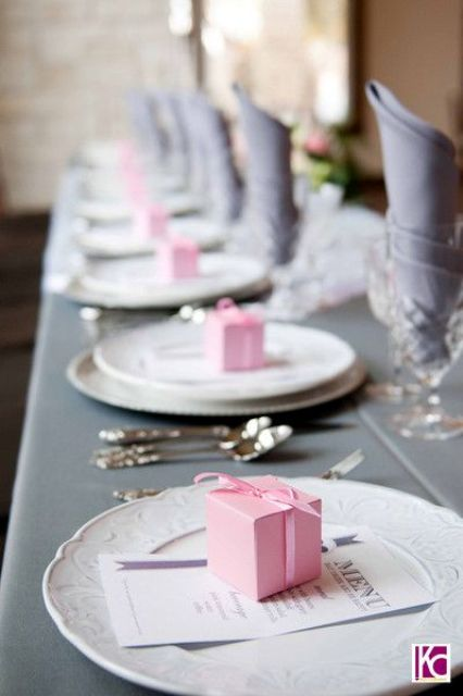 grey tablecloth and napkins, pink gift boxes
