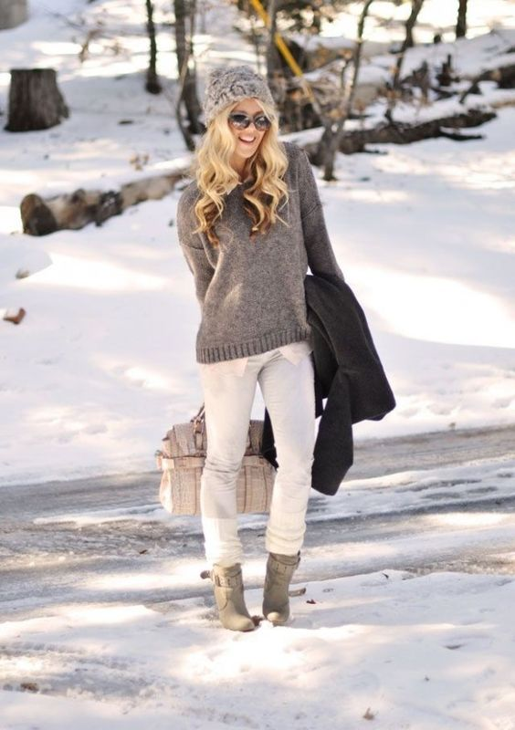 white jeans, a grey sweater and beanie, grey ankle boots