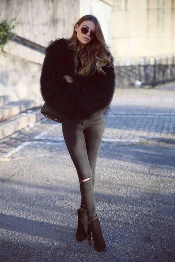 all-black look with a fuzzy coat and suede boots