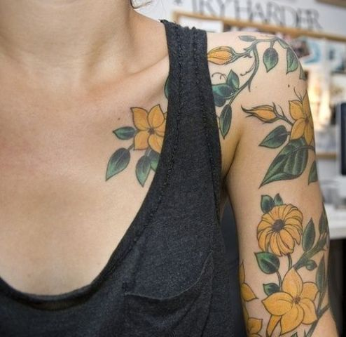 Yellow and green tattoo