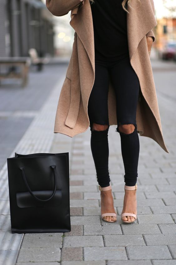 black ripped skinnies, blush heels, a black tee and a camel coat