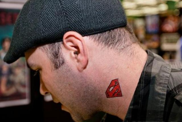 Red superman sign tattoo