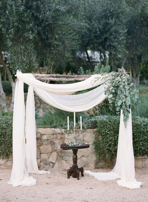 rustic wedding arch with fabric and eucalyptus for decor
