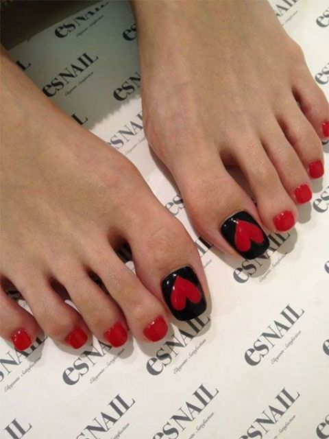 red and black pedicure with large hearts