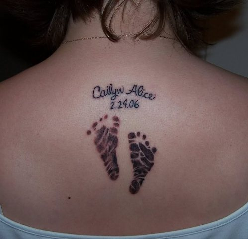 Baby footprint tattoo on the back