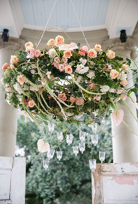 peach-and-pink roses chandelier, greenery and hanging crystals for extra romance