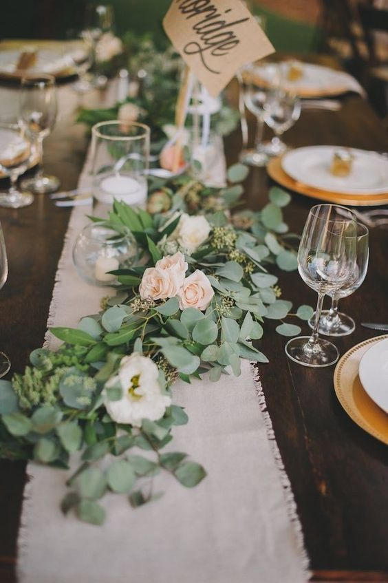 messy eucalyptus and blush roses table garland