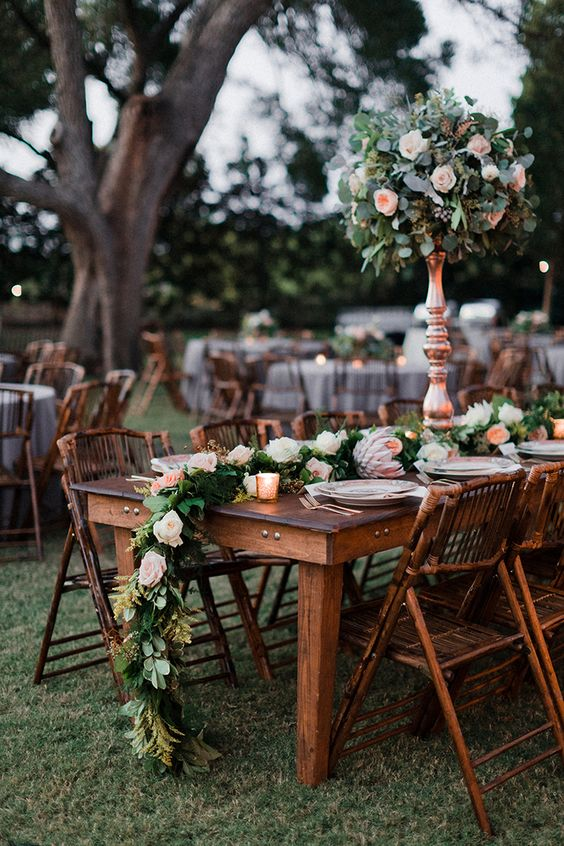 chic blush rose pomanders and table runners echo with each other