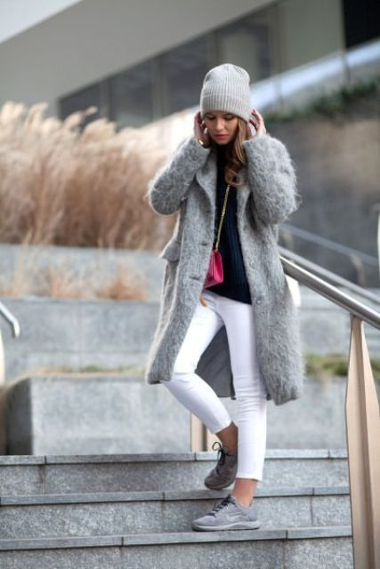 white jeans, grey trainers, a navy sweater and a fuzzy grey coat