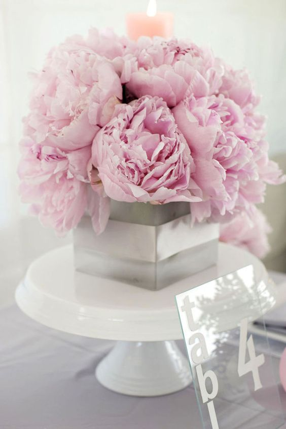pink peonies in a grey box with ribbon