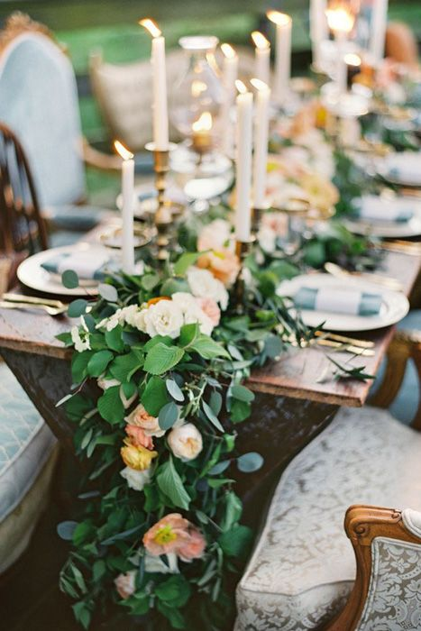 lush greenery and peach-colored flower garland for table decor