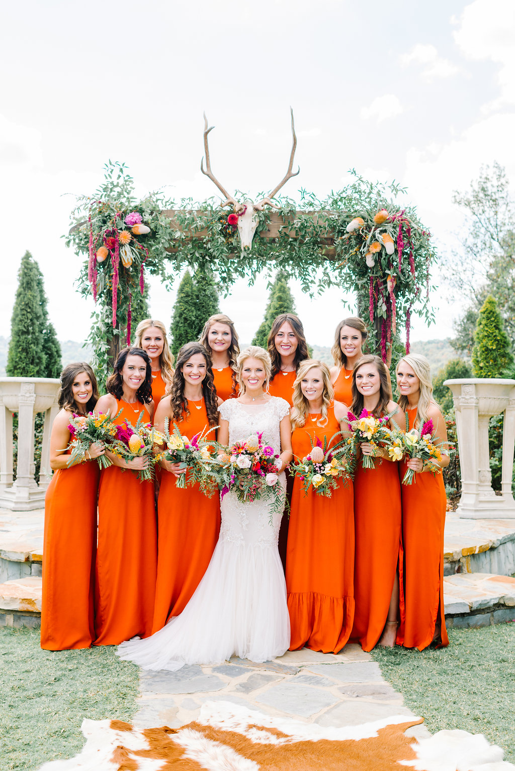 bridesmaids in orange - photo by Cathrine Taylor Photography http://ruffledblog.com/colorful-alabama-wedding-with-desert-accents