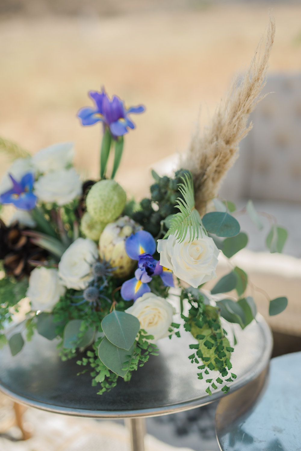 wedding flower centerpieces - photo by Anya Kernes Photography http://ruffledblog.com/organic-wedding-inspiration-with-shades-of-blue