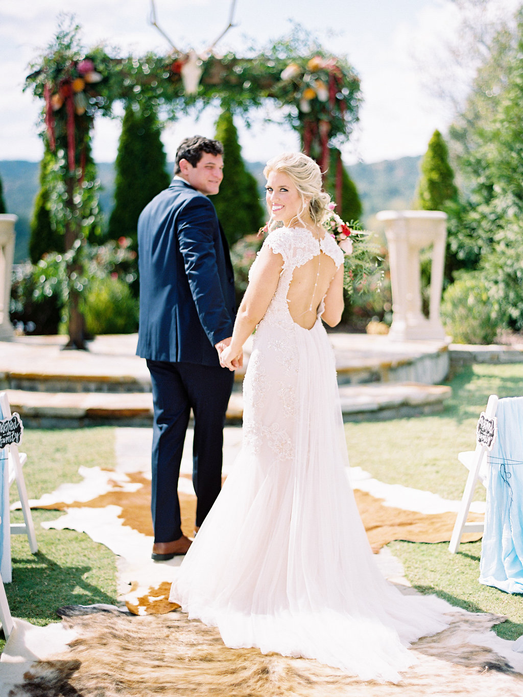 bride and groom - photo by Cathrine Taylor Photography http://ruffledblog.com/colorful-alabama-wedding-with-desert-accents