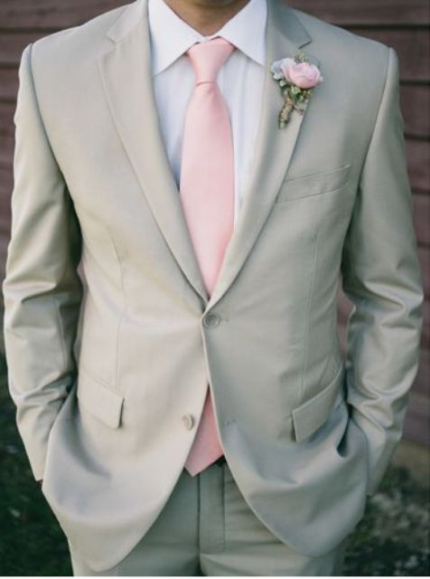 light grey suit with a light pink tie and boutonniere