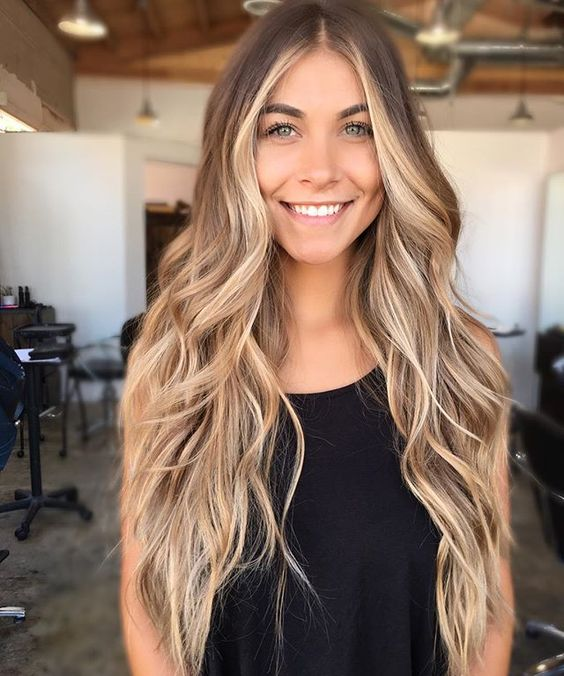 long chestnut hair with cool honey and blonde strands