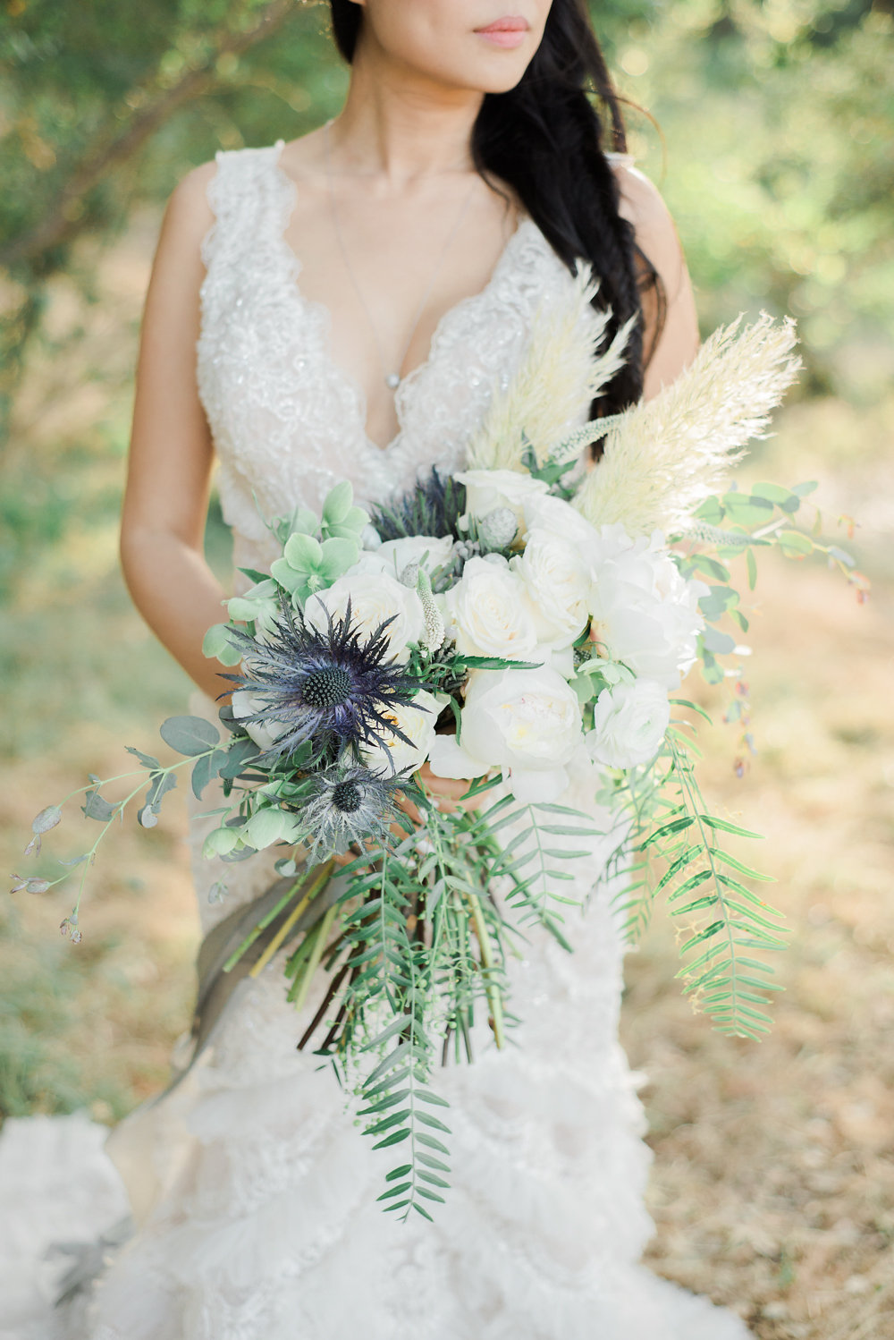 bouquet with thistle and greenery - photo by Anya Kernes Photography http://ruffledblog.com/organic-wedding-inspiration-with-shades-of-blue