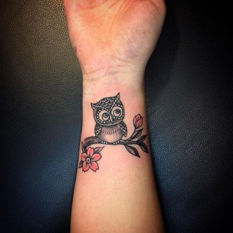 Owl with flowers tattoo