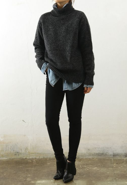 black denim, a chambray shirt, an oversized black sweater and ankle boots