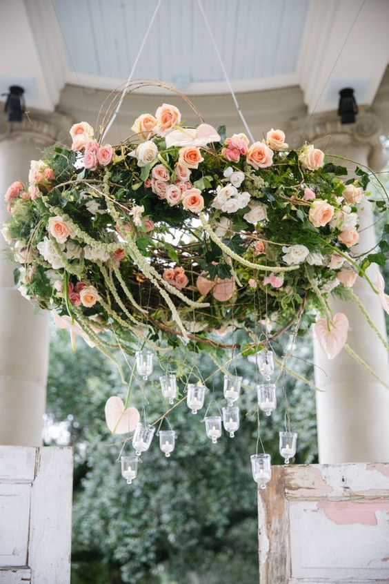 28 blush rose chandelier with candle holders has a strong wow factor