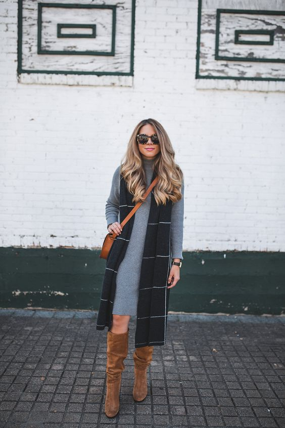 grey sweater dress, a long vest and ocher suede boots
