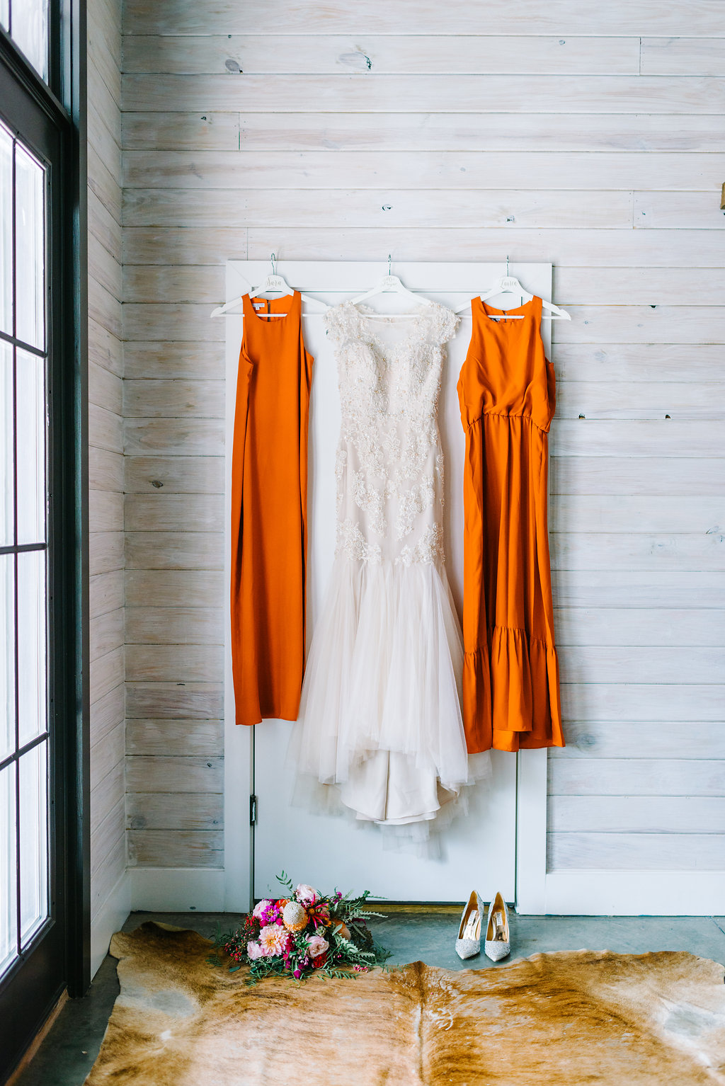 orange bridesmaid dresses - photo by Cathrine Taylor Photography http://ruffledblog.com/colorful-alabama-wedding-with-desert-accents