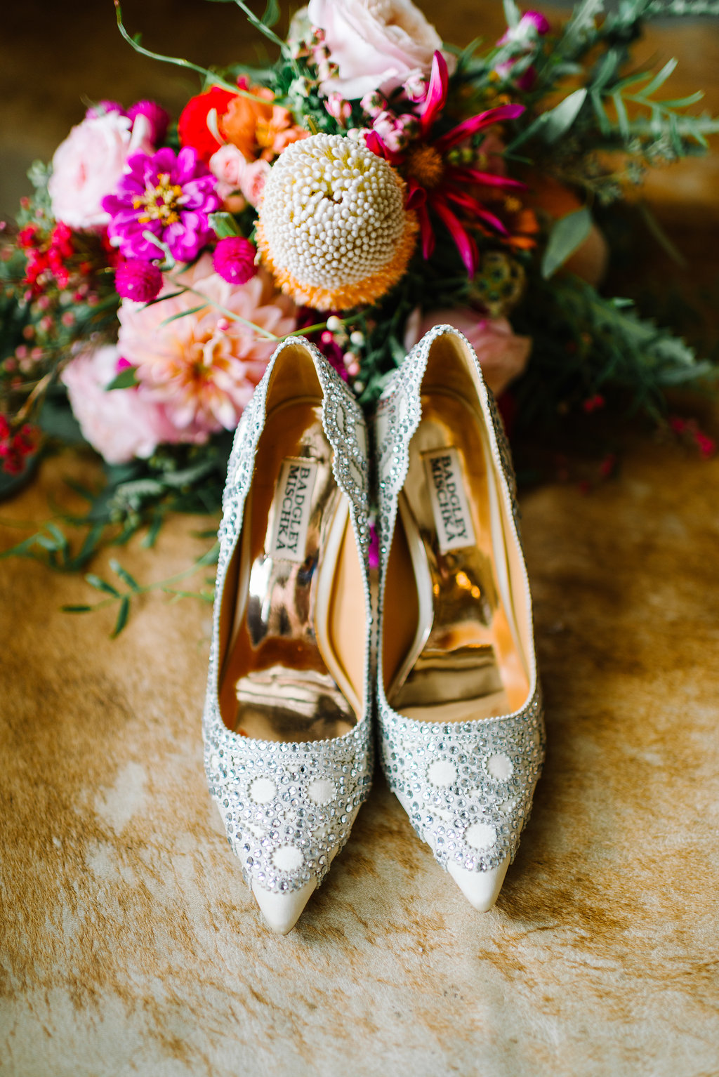 silver wedding shoes - photo by Cathrine Taylor Photography http://ruffledblog.com/colorful-alabama-wedding-with-desert-accents