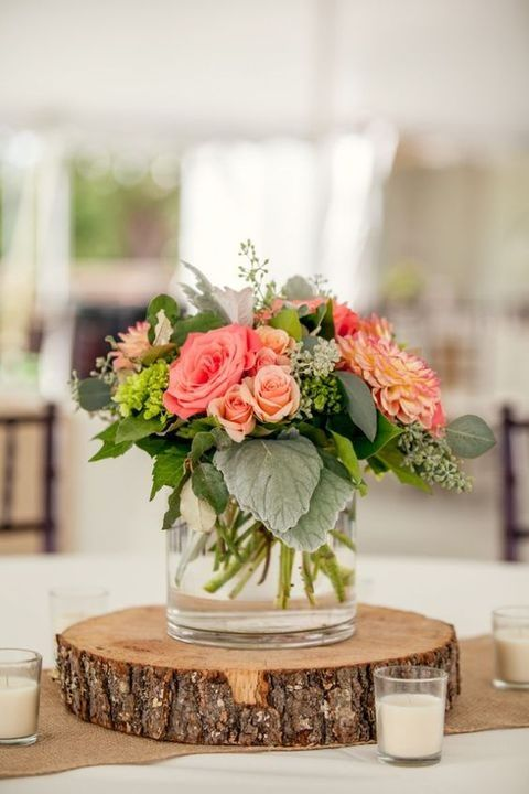 wood slice with a vase with bold florals
