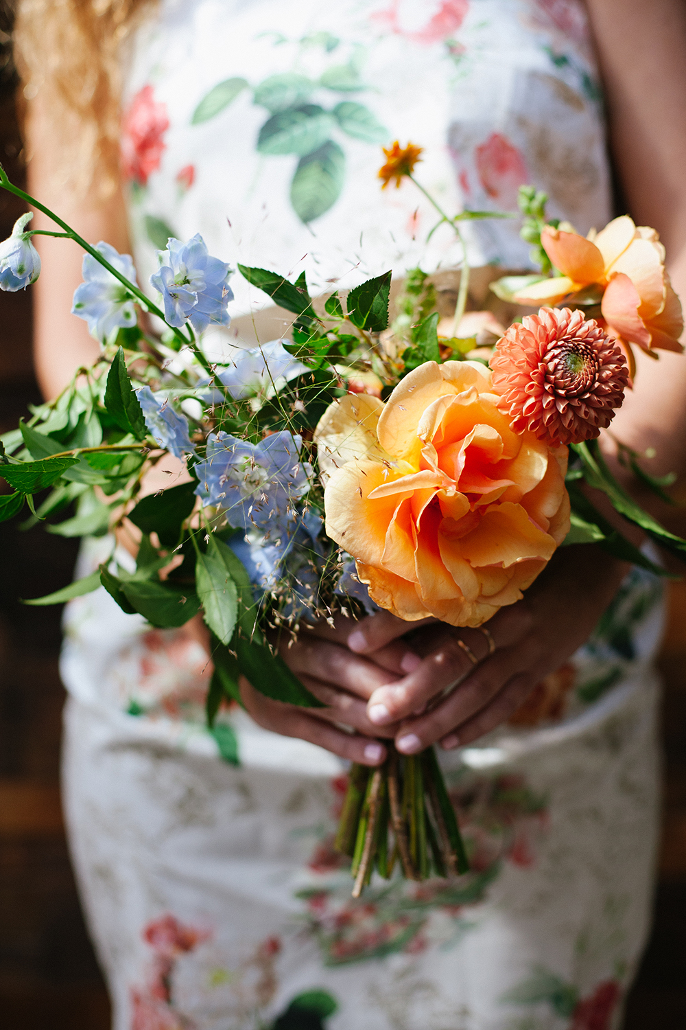 bouquets with orange - photo by Levi Stolove Photography http://ruffledblog.com/botanical-wedding-with-a-mint-green-wedding-dress