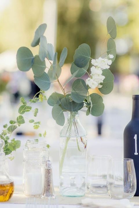 simple eucalyptus and flower centerpice in a sheer vase