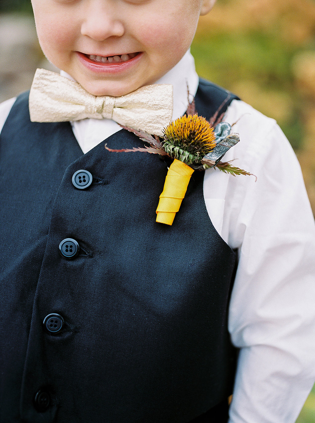 ring bearer boutonniere - photo by Alexandra Elise Photography http://ruffledblog.com/cobalt-and-amber-wedding-inspiration