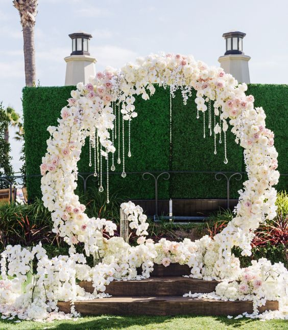 unique white flower wedding ceremony chuppah with crystals